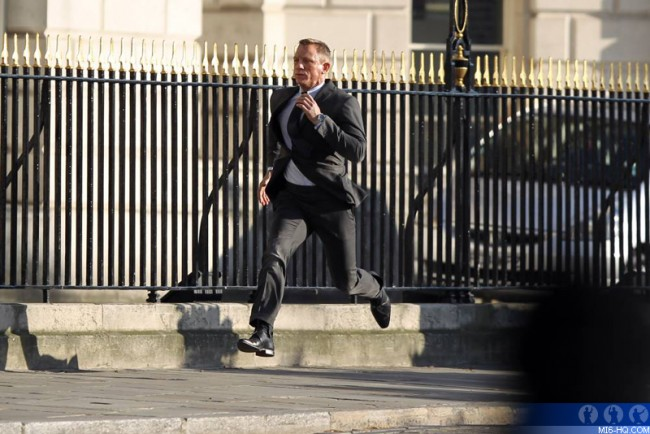 james bond running in a suit