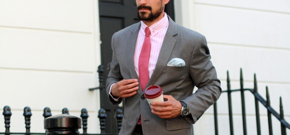 grey suit pink shirt coffee